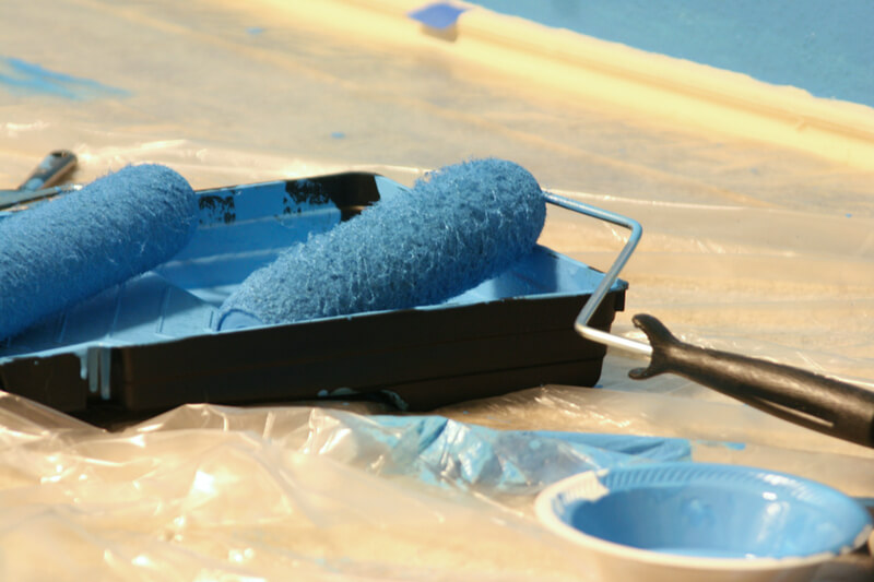 Paint Roller in Tray with Blue Paint