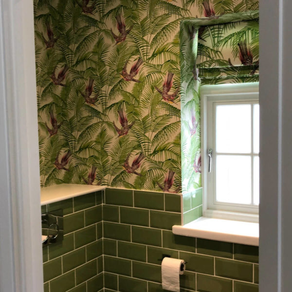 Bathroom with Feature Wall Paper and Green Tiles