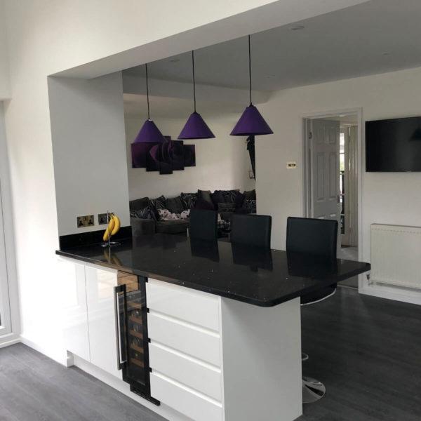 Modern White Kitchen with Black Work Surfaces