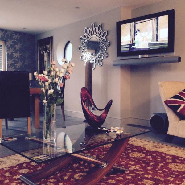 Living Room - Grey Walls, Red Rug, Wall Mounted TV